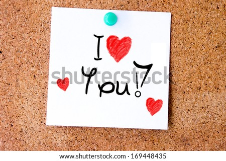 Post it note on wood in white with I love you - stock photo