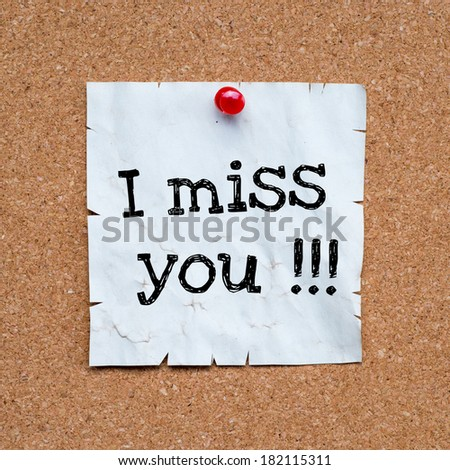 Post it note white with i miss you message on cork - stock photo