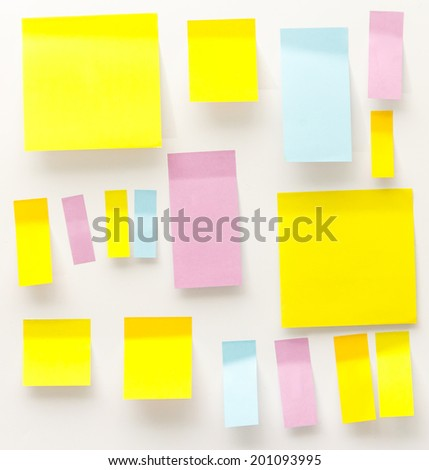 post it notes isolated on wooden background. - stock photo