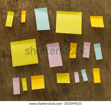 post it notes isolated on wooden background.