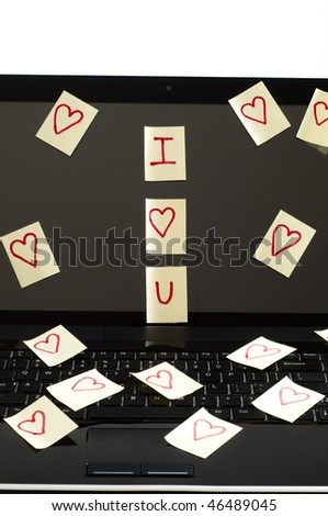 Post it notes with harts  scatered over  computer screen  with i love you