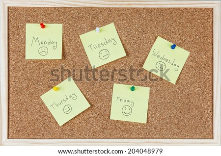 Post-it notes with weekdays and smileys sticked on corkboard. - stock photo