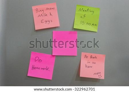 Post it on the fridge. - stock photo