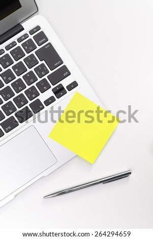 Post note on a laptop computer. - stock photo