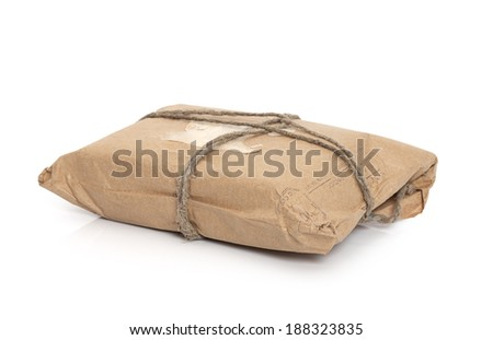 Post Parcel  tied with a string, isolated on white background  - stock photo