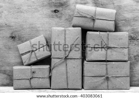 Postage on the background of an old wooden board.Black and white photography. - stock photo