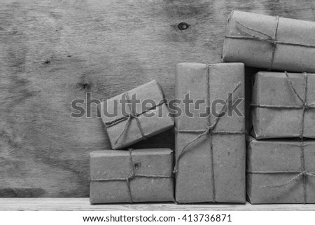 Postage on the background of an old wooden board. Black and white photography. - stock photo