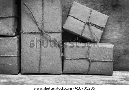 Postage on the background of an old wooden board . Black and white photography. - stock photo