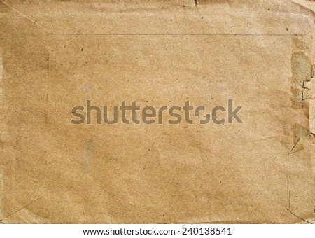 Postal envelope made of light brown recycled paper. - stock photo