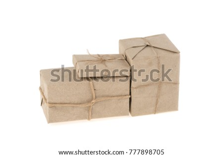 postal packet packed in gray paper bundled rope isolated on white background