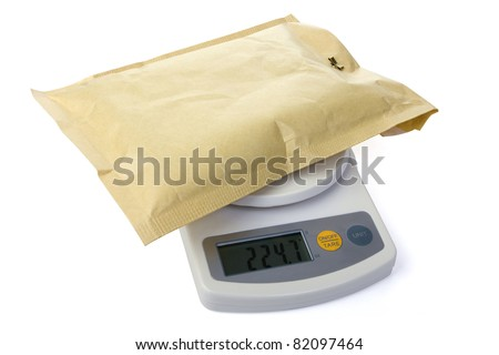 Postal scale with letter over white - stock photo