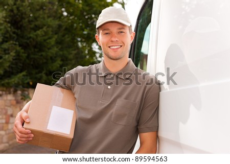 Postal service - delivery of a package through a delivery service; the postman is leaning on his van