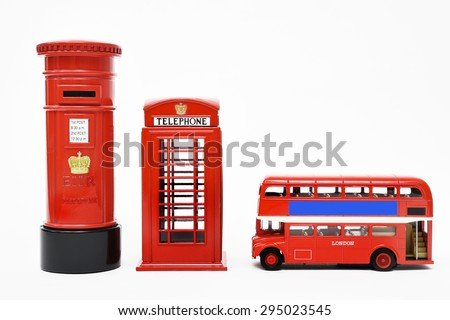 Postbox and red telephone box with red bus. - stock photo