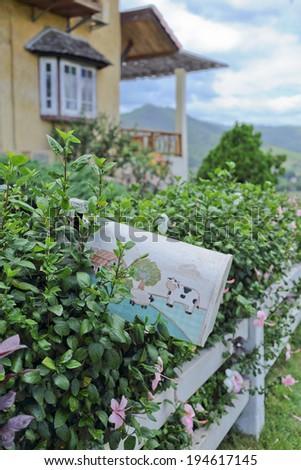 postbox on garden background - stock photo