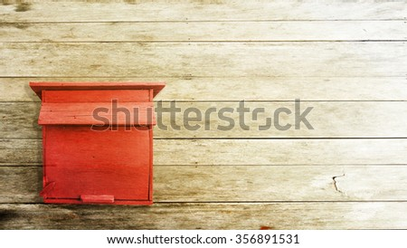 postbox on the wood background - stock photo