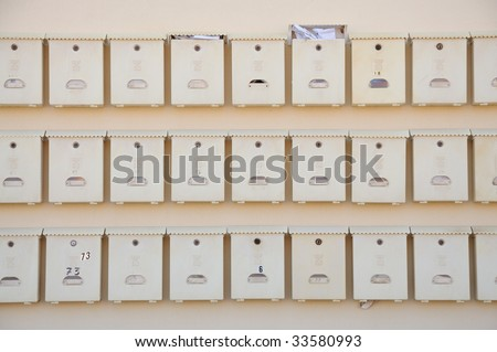 Postboxes on the wall on an apartment house - stock photo