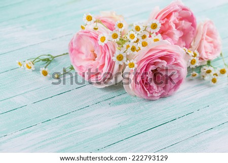 Postcard with daisy flowers and fresh roses on  wooden background. Selective focus - stock photo