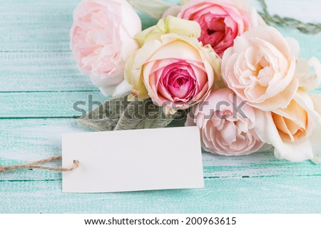 Postcard with fresh flowers and empty tag for your text. - stock photo