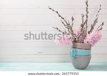 Postcard with hyacnths iand willow flowers in vase and empty place  for your text.