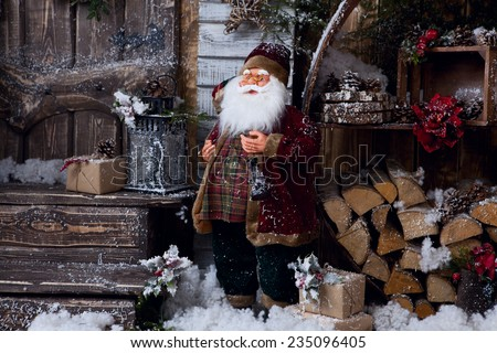postcard with Santa Claus in decorative room - stock photo
