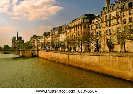 Postcards from Paris: river Seine, cathedral Notre Dame and townhouses in sunny Parisian days. France, Europe. - stock photo