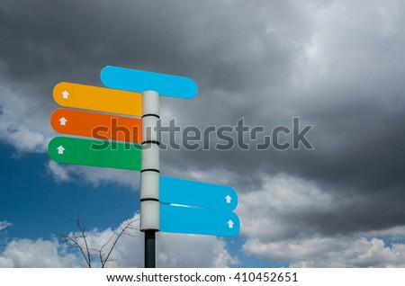 Poste with directions signs