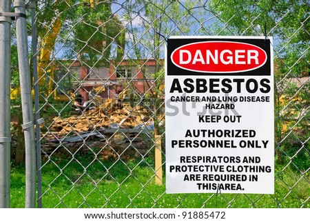 Posted Asbestos on Fence - stock photo