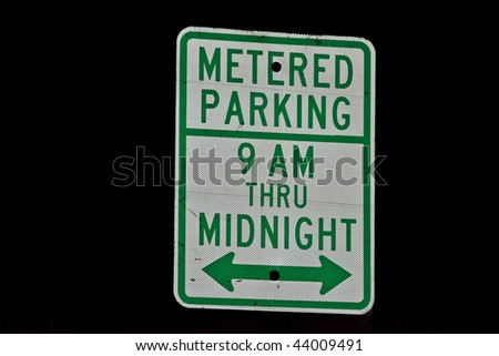 Posted Parking Meter Sign that says metered parking 9am thru Midnight - stock photo