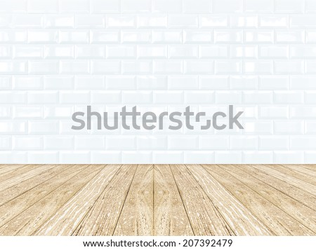 Poster frame at Tiles ceramic room wall with wooden plank floor - stock photo