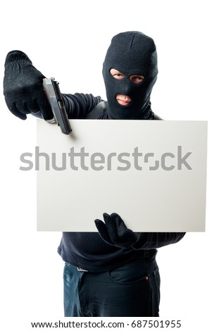 Poster in the hands of a criminal in a black mask with a gun on a white background