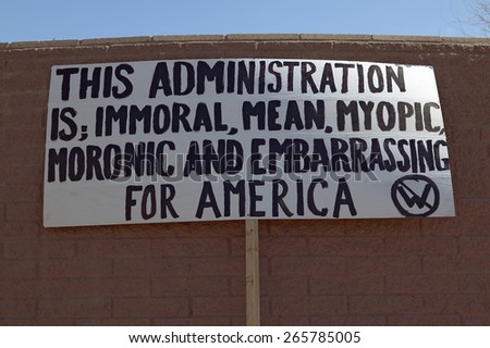 Poster sign protesting the policies of President George W. Bush's administration in Tucson, Arizona - stock photo