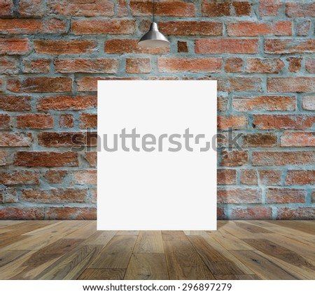 Poster standing in Brick wall with Ceiling lamp for information message - stock photo