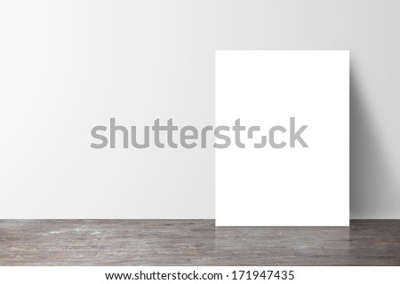 poster standing next to a white wall - stock photo