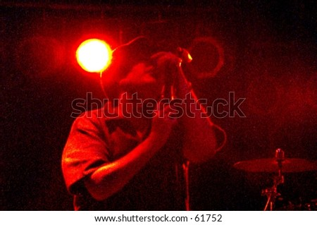Posterized image of a singer performing in front of stage lights. - stock photo