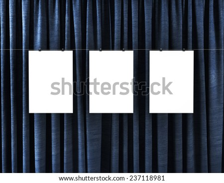 Posters on a background of blue curtains. - stock photo