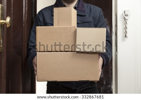 Postman brings a lot packages - stock photo
