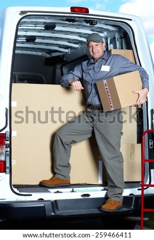 Postman with parcel box. Postal delivery service. - stock photo