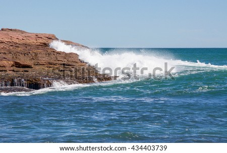 Pot Alley coast line with red sandstone outcroppings and Indian Ocean waters in Kalbarri, Western Australia/Sandstone Outcropping/Pot Alley, Kalbarri, Western Australia - stock photo