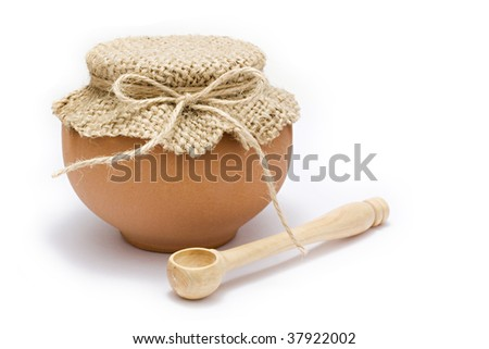 pot and wooden spoon isolated - stock photo