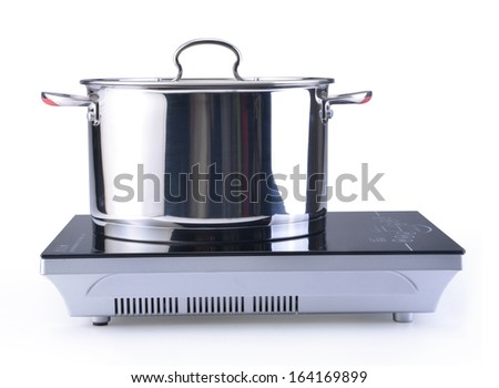 pot at the induction stove over the white background  - stock photo