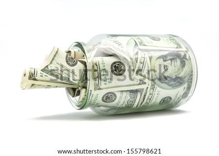 pot full of tickets for hundred wrinkled dollars - stock photo