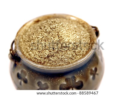 Pot of Gold Dust collected by leprechauns from mines at the ends of rainbows. - stock photo