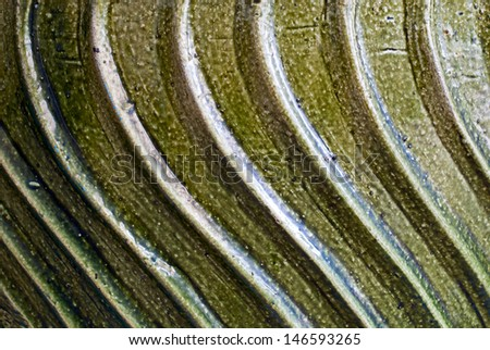Pot of green glaze.. texture background - stock photo