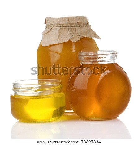 pot of honey and jar isolated on white background - stock photo