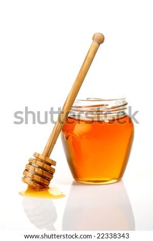 Pot of honey isolated on white - stock photo