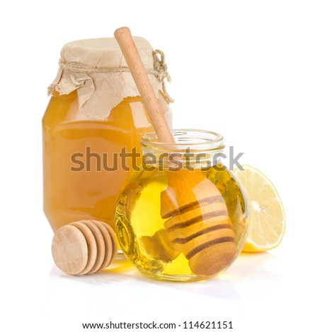 pot of honey isolated on white background - stock photo