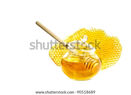 Pot of honey with stick and bee honeycomb isolated on white background. Honey spoon in glass jar and honeycombs wax. - stock photo
