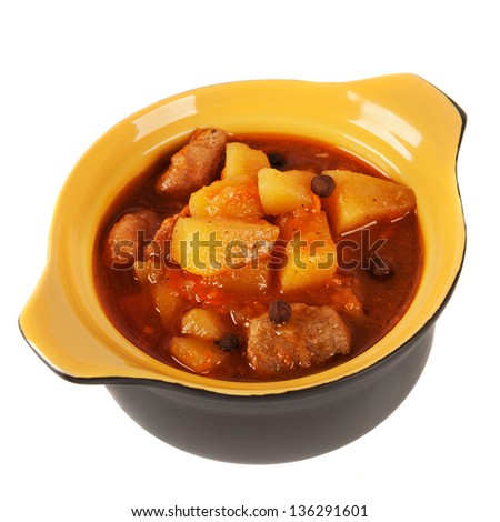 Pot of stewed potatoes. On a white background. - stock photo