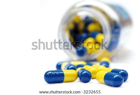 pot of yellow and blue capsule pills