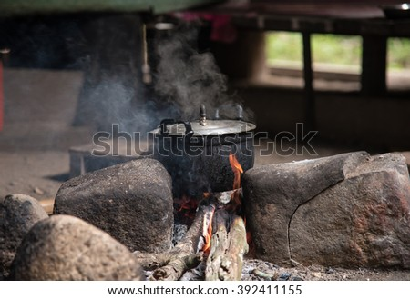Pot on  fire for cook the rice (Thai traditional way)